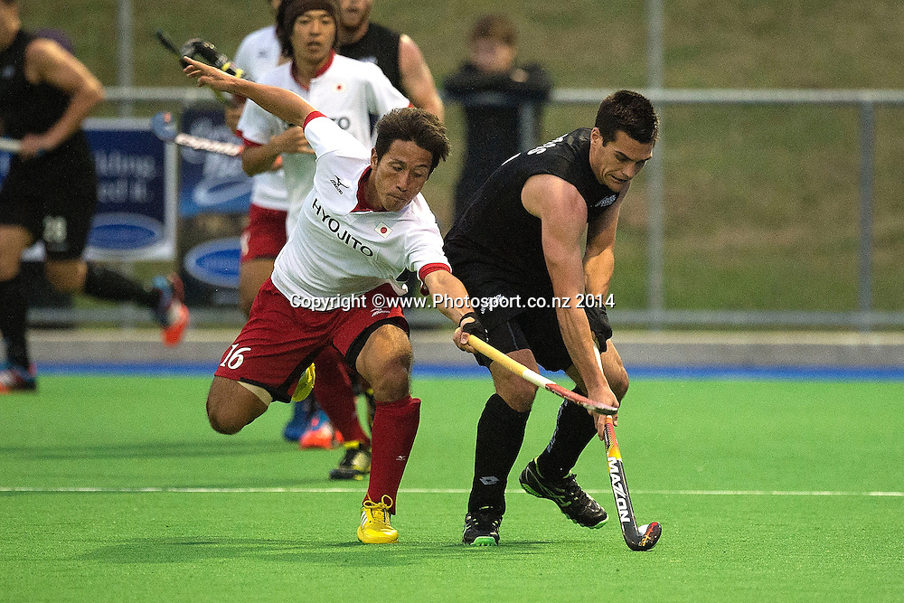 Nick Ross (R of New Zealand is tackled by Ryohei Kawakami of Japan during the Black Sticks Men v Japan international hockey match at the Coastlands Kapiti Sports Turf in Paraparaumu on Friday the 21st of November 2014. Photo by Marty Melville/www.Photosport.co.nz