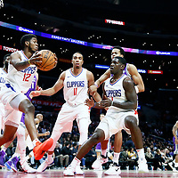 12 October 2017: LA Clippers guard Tyrone Wallace (12) grabs the rebound in front of LA Clippers forward Brice Johnson (11) during the LA Clippers 104-87 victory over the Sacramento Kings, at the Staples Center, Los Angeles, California, USA.