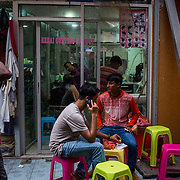 A group of Bangladeshi hang out in front of a barber shop at the back lane of Jalan Tun Tan Siew Sin in Kuala Lumpur on November 8, 2017.