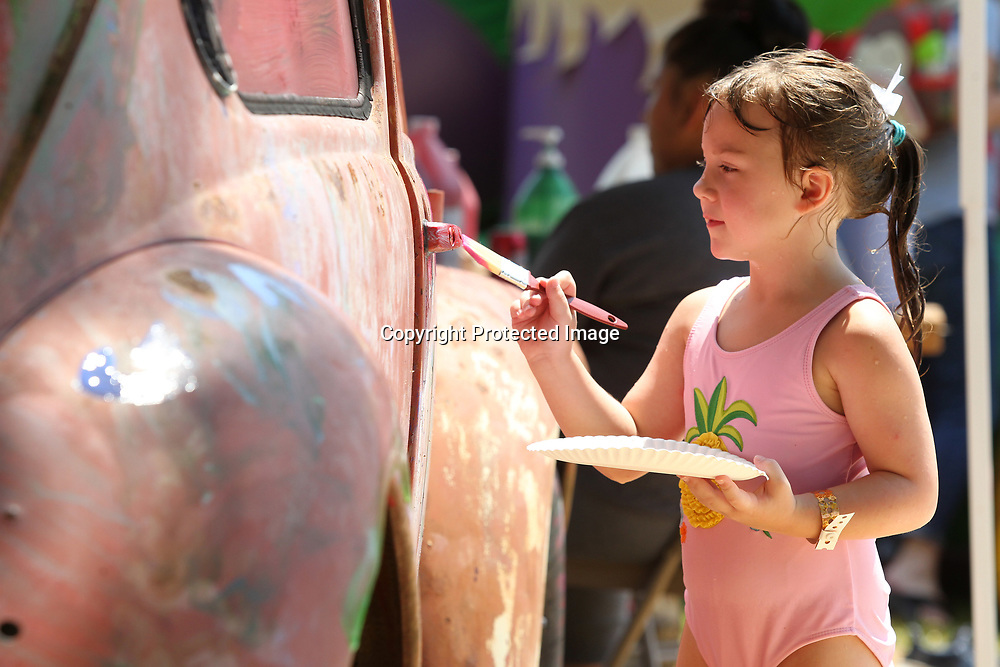 McKenzie Edwards, 5, of Saltillo, paints the Volkswagen Beetle while attending the 2019 Dudie Burger Festival Saturday morning at the Oren Dunn City Museum.