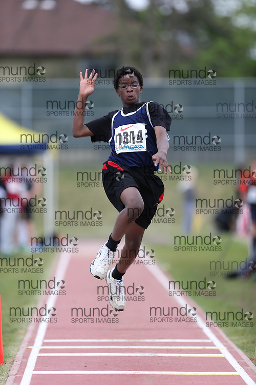 Solomon Awobem of Niagara Christian - Fort Erie competes in the midget boys triple jump at the 2013 OFSAA Track and Field Championship in Oshawa Ontario, Thursday,  June 6, 2013.<br /> Mundo Sport Images / Sean Burges