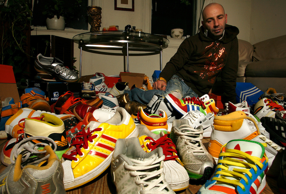 Gilad Ankari 36 sitting with in his sneakers in his living room at Jersey City NJ...Tuesday December 04 ,2007.....Gilad is addicted to sneakers as he say ?I can?t pass in the street and see special sneakers and not to buy them?...He had moor then 250 pairs of sneakers...He spend in the last year between 8000- 10000 $ on sneakers...He start to collect them wean he was 21 and since then he spend moor then 60000 $ on sneakers...
