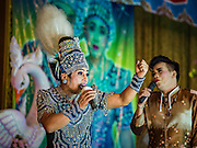 "30 JANUARY 2016 - NONTHABURI, NONTHABURI, THAILAND:  A ""likay"" opera performance at Wat Bua Khwan in Nonthaburi, north of Bangkok. Likay is a form of popular folk theatre that includes exposition, singing and dancing in Thailand. It uses a combination of extravagant costumes and minimally equipped stages. Intentionally vague storylines means performances rely on actors' skills of improvisation. Like better the known Chinese Opera, which it resembles, Likay is performed mostly at temple fairs and privately sponsored events, especially in rural areas. Likay operas are televised and there is a market for bootleg likay videos and live performance of likay is becoming more rare.    PHOTO BY JACK KURTZ"