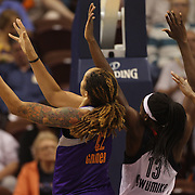 Brittney Griner, (left), Phoenix Mercury, drives to the basket past Chiney Ogwumike, Connecticut Sun, during the Connecticut Sun Vs Phoenix Mercury WNBA regular season game at Mohegan Sun Arena, Uncasville, Connecticut, USA. 23rd May 2014. Photo Tim Clayton