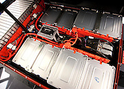 "Forty-eight lithium ion batteries stack together to create one large energy source for the 100% electric Nissan Leaf.  Jokingly referred to as ""sardine cans"", the li-on batteries at peak charge will garner a 100 mile per charge range for the Leaf that is said to have a top speed of 90 mph."