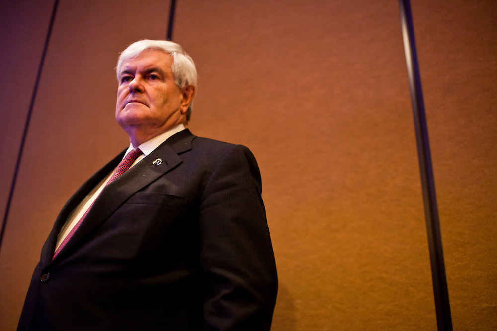 Republican presidential candidate Newt Gingrich waits to speak to the annual meeting of the Iowa Association of Electric Cooperatives on Thursday, December 1, 2011 in West Des Moines, IA.
