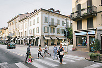 COMO, ITALY - 21 JUNE 2017: A mix of local residents of Como and migrants are seen here crossing the street in via Milano in Como, Italy, on June 21st 2017.<br /> <br /> Residents of Como are worried that funds redirected to migrants deprived the town's handicapped of services and complained that any protest prompted accusations of racism.<br /> <br /> Throughout Italy, run-off mayoral elections on Sunday will be considered bellwethers for upcoming national elections and immigration has again emerged as a burning issue.<br /> <br /> Italy has registered more than 70,000 migrants this year, 27 percent more than it did by this time in 2016, when a record 181,000 migrants arrived. Waves of migrants continue to make the perilous, and often fatal, crossing to southern Italy from Africa, South Asia and the Middle East, seeing Italy as the gateway to Europe.<br /> <br /> While migrants spoke of their appreciation of Italy's humanitarian efforts to save them from the Mediterranean Sea, they also expressed exhaustion with the country's intricate web of permits and papers and European rules that required them to stay in the country that first documented them.