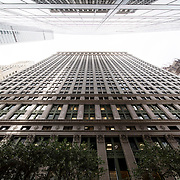 March 14, 2018 - New York, NY : The century-old Equitable Building, whose construction atop an entire city block at 120 Broadway in Lower Manhattan inspired the establishment of zoning regulations, has been undergoing a series of changes including the recent creation of a public hearing room for the Department of City Planning. Further renovation by the building's owner, Silverstein Properties, to be carried out by the architecture firm Beyer Blinder Belle and the landscape architecture firm MPFP, are also underway. Here, a view of the building's Cedar Street-facing facade, which stretches all the way between Broadway and Nassau St.  CREDIT: Karsten Moran for The New York Times