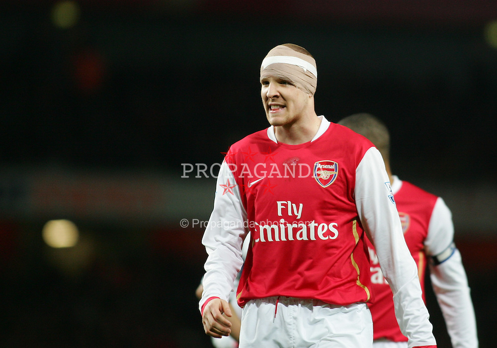 LONDON, ENGLAND - Wednesday, January 31, 2007: Arsenal's Philippe Senderos, with a bandaged head, in action against Tottenham Hotspur during the Football League Cup Semi-Final 2nd Leg at the Emirates Stadium. (Pic by Chris Ratcliffe/Propaganda)