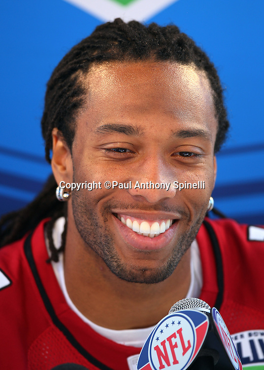 TAMPA, FL - JANUARY 27: Wide receiver Larry Fitzgerald #11 of the NFC Arizona Cardinals speaks to the media during Super Bowl XLIII Media Day at Raymond James Stadium on January 27, 2009 in Tampa, Florida. ©Paul Anthony Spinelli *** Local Caption *** Larry Fitzgerald
