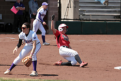 19 April 2014:  Stephanie Gallant slides into second ahead of the throw to Michal Luckett during an NCAA women's softball game between the Evansville Purple Aces and the Illinois State Redbirds on Marian Kneer Field in Normal IL