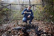 Tramutola, Italia - Dario Avagliano, exploration manager di Eni ritratto mentre mostra del petrololio attaccatosi ad un bastone vicino ad una  &quot;sorgente&quot; di petrolio nel comune di Tramutola in Basilicata. Il petrolio, in piccolissime quantit&agrave; fuoriesce dal sottosuolo e si deposita sui bordi di un piccolo torrente.<br /> Ph. Roberto Salomone