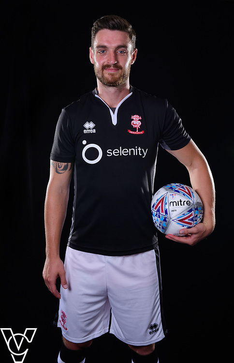 Lincoln City Football Club kit launch ahead of the 2017/18 EFL Sky Bet League Two season.  Pictured is, from left, Lincoln City's Luke Waterfall wearing the black Errea away shirt, with the Selenity (formerly called Software Europe) logo on the front.<br /> <br /> Picture: Chris Vaughan Photography<br /> Date: June 19, 2017