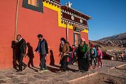 Tibetans walk laps around Rabgya temple in prayer. Golok region, Tibet (Qinghai, China).