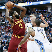 22 March 2017: Cleveland Cavaliers center Tristan Thompson (13) goes for the basket against Denver Nuggets guard Jameer Nelson (1) and Denver Nuggets forward Nikola Jokic (15) during the Denver Nuggets 126-113 victory over the Cleveland Cavaliers, at the Pepsi Center, Denver, Colorado, USA.