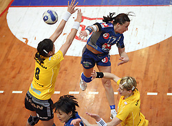 Tatjana Oder of Krim between Cristina Neagu (L) and  Simona Vintila  of Rulmentul-Urban at handball match of 1/4 finals of Women handball Cup Winners cup between RK Krim Mercator, Ljubljana and C.S. Rulmentul-Urban Brasov, Romania, in Arena Kodeljevo, Ljubljana, Slovenia, on 8th of March 2008. Rulmentul-Urban won match against RK Krim Mercator with 29:27.