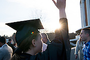 Molly Mcilvain waves to her family following commencement. Photo by Ben Siegel