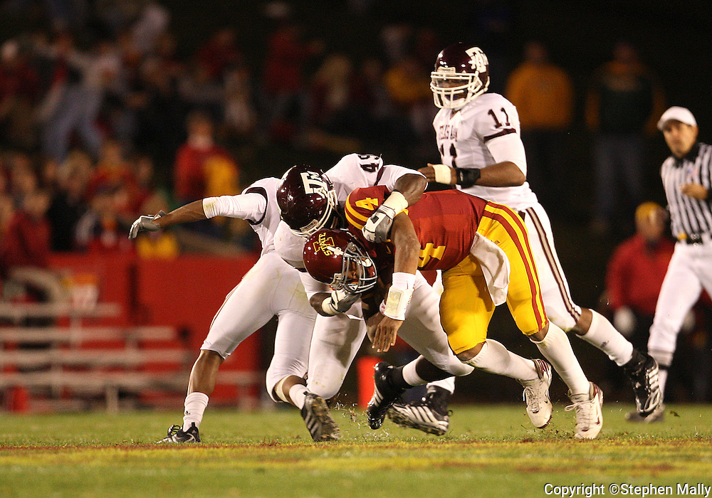 25 OCTOBER 2008: Iowa State quarterback Austen Arnaud (4) his brought down by Texas A&M defensive lineman Cyril Obiozor (49) in the first half of an NCAA college football game between Iowa State and Texas A&M, at Jack Trice Stadium in Ames, Iowa on Saturday Oct. 25, 2008. Texas A&M beat Iowa State 49-35.