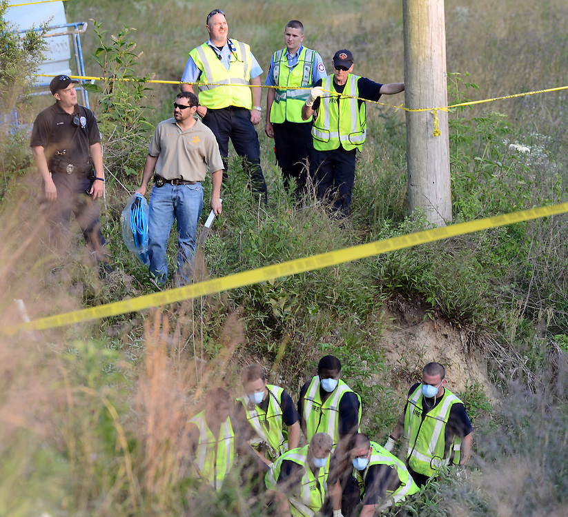 Members of the Hattiesburg Police and Fire departments as well as Forrest County Coroners Office personnel work at the scene where an unidentified person was found dead in a tributary of the Bowie River near Rawls Springs Rd. on Tuesday around 5:30 p.m. Bryant Hawkins/The Hattiesburg American .
