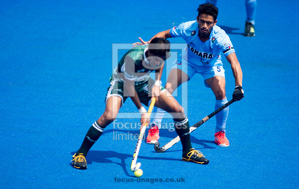 Muhammad Irfan Jr of Pakistan and Kothajit Khadangbam of India battle for the ball on day four of the Men's Hero Hockey World League Semi-Finals at Lee Valley Hockey Centre, Stratford<br /> Picture by Hannah Fountain/Focus Images Ltd 07814482222<br /> 18/06/2017