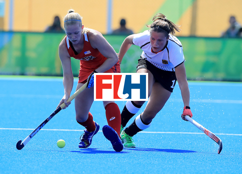 RIO DE JANEIRO, BRAZIL - AUGUST 15:  Stefanie Fee #2 of the United States attempts a pass against Charlotte Stapenhorst #12 of Germany at Olympic Hockey Centre on August 15, 2016 in Rio de Janeiro, Brazil.  (Photo by Sam Greenwood/Getty Images)