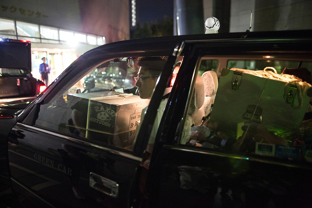TOKYO, JAPAN - JULY 10 : Election staff members arrived with the ballot box using taxi for official counting of the ballots in Parliament's upper house elections at a ballot counting center in Shinjuku Cosmic Sports Center in Shinjuku-ku on Sunday, July 10, 2016 in Tokyo, Japan. (Photo by Richard Atrero de Guzman/NUR Photo)