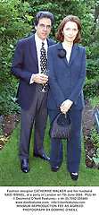 Fashion designer CATHERINE WALKER and her husband SAID ISMAEL, at a party in London on 7th June 2004.PUU 64