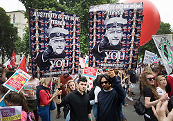 © Licensed to London News Pictures. 01/07/2017. London, UK. Protestors on the People's Assembly anti-austerity demonstration carry placards with photographs of Jeremy Corbyn as Lord Kitchener. Photo credit: Peter Macdiarmid/LNP