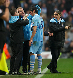 MANCHESTER, ENGLAND - Sunday, January 8, 2012: Manchester City's Stefan Savic, receives treatment for a head injury, against Manchester United during the FA Cup 3rd Round match at the City of Manchester Stadium. (Pic by David Rawcliffe/Propaganda)