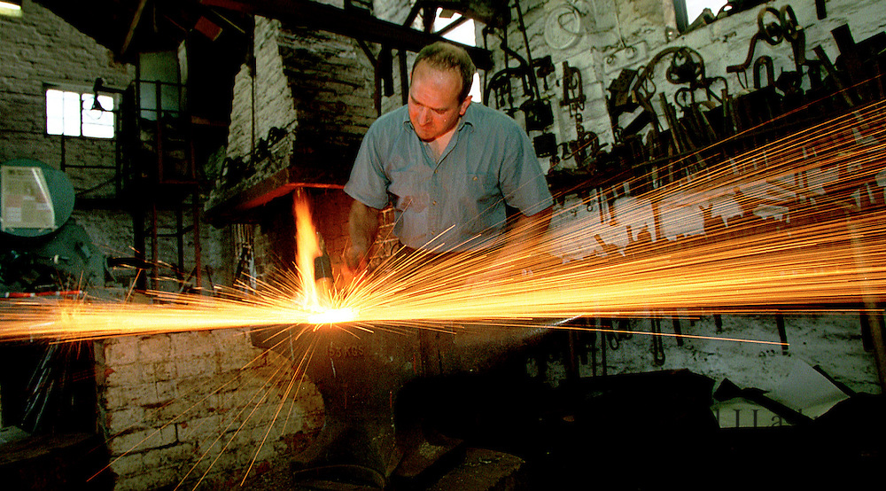 A blacksmith at work in his forge in the Northamptonshire village of Broughton