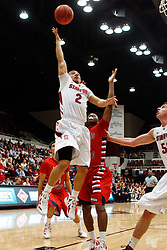 Nov 14, 2011; Stanford CA, USA;  Stanford Cardinal guard Aaron Bright (2) shoots past Fresno State Bulldogs guard Kevin Olekaibe (3) during the first half of a preseason NIT game at Maples Pavilion. Mandatory Credit: Jason O. Watson-US PRESSWIRE