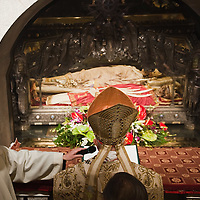 MILAN, ITALY - DECEMBER 07:  Cardinal Dionigi Tettamanzi, Archibishop of Milan, prays in front of the relics of Saint Ambrogio on December 7, 2010 in Milan, Italy. The skeleton of Saint Ambrogio lays with the remains of San Gervasio e San Protasio in the ancient basilica of Sant'Ambrogio in the city centre of Milan