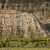 Gist Bottom, sun rising on bluffs, Upper Missouri RIver Breaks National Monument, Montana, Wild and Scenic Missouri River, russel country, montana, usa, upper missouri river breaks national monument, russell