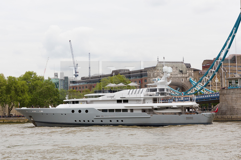 © Licensed to London News Pictures. 13/05/2018. London, UK. Alan Sugar sails his luxury superyacht, Lady A on the River Thames this afternoon after it passed under Tower Bridge and parades in the Upper Pool in central London, before passing under Tower Bridge again and travelling east along the river. Alan Sugar reportedly purchased the 181 feet long yacht in 2015 and renamed her Lady A after his wife, Ann and it includes a jacuzzi and can sleep up to 12 guests. Lady A is reportedly still up for sale at around £13m after being put on the market last year, or it can be chartered with prices starting from around £12,500 per week. . Photo credit: Vickie Flores/LNP