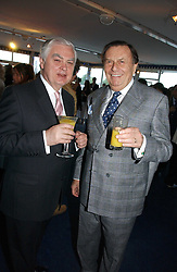 Left to right, LORD LAMONT and BARRY HUMPHRIES at a party hosted by Sonia & Andrew Sinclair at The Westminster Boating Base, 136 Grosvenor Road, London SW1 on 5th June 2006.<br />
