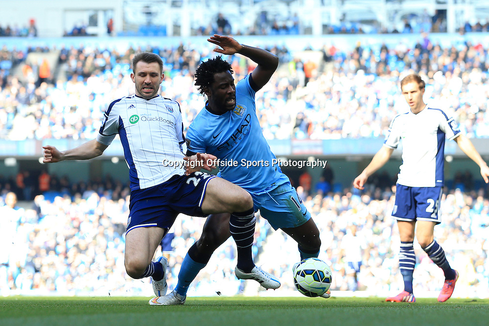 21st March 2015 - Barclays Premier League - Manchester City v West Bromwich Albion - Gareth McAuley of West Brom fouls Wilfried Bony of Man City to earm himself a sending-off - Photo: Simon Stacpoole / Offside.