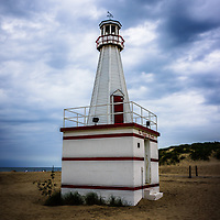 Photo of lighthouse in New Buffalo Michigan with the beach and Lake Michigan.
