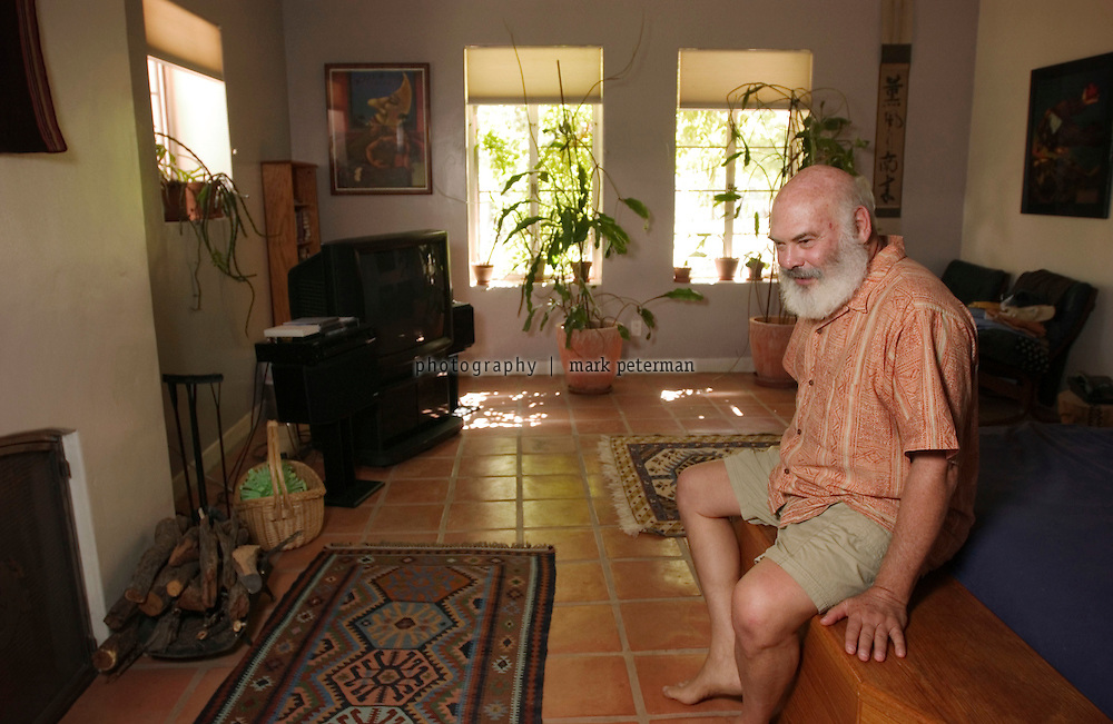 Dr. Andrew Weil in the bedroom of his home located on a 120 acre ranch that borders on the Saguaro National Park about 15 miles south of Tucson, Arizona.