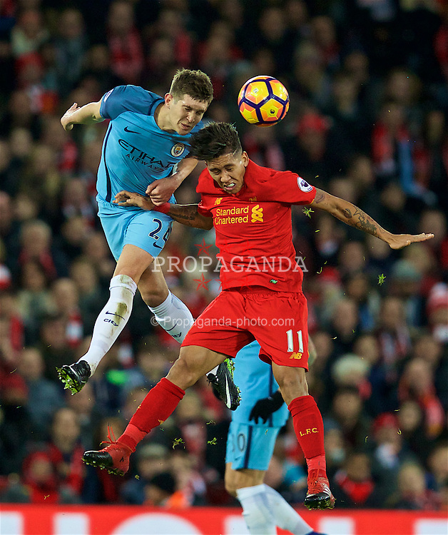 LIVERPOOL, ENGLAND - Saturday, December 31, 2016: Liverpool's Roberto Firmino in action against Manchester City's John Stones during the FA Premier League match at Anfield. (Pic by David Rawcliffe/Propaganda)