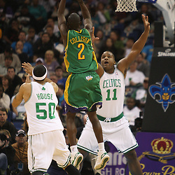 Feb 10, 2010; New Orleans, LA, USA; New Orleans Hornets guard Darren Collison (2) shoots over Boston Celtics forward Glen Davis (11) and guard Eddie House (50) during the first half at the New Orleans Arena. Mandatory Credit: Derick E. Hingle-US PRESSWIRE