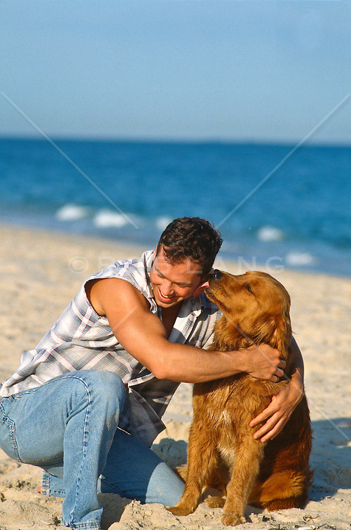 Man being licked by a Golden Retriever <br /> On The Beach in East Hampton, NY