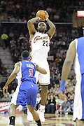 Jan 31, 2010; Cleveland, OH, USA; Cleveland Cavaliers forward LeBron James (23) shoots a three over Los Angeles Clippers guard Baron Davis (1) during the first quarter at Quicken Loans Arena. Mandatory Credit: Jason Miller-US PRESSWIRE