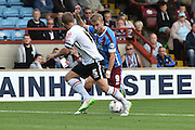 Paddy Madden beats Marcus Haber  and scores second goal during the Sky Bet League 1 match between Scunthorpe United and Crewe Alexandra at Glanford Park, Scunthorpe, England on 15 August 2015. Photo by Ian Lyall.