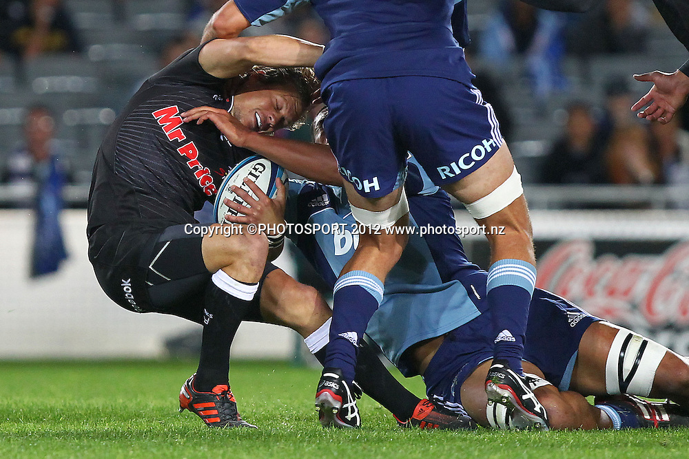 Sharks' Charl McLeod is tackled. Super Rugby rugby union match, Blues v Sharks at Eden Park, Auckland, New Zealand. Friday 13th April 2012. Photo: Anthony Au-Yeung / photosport.co.nz