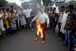August 4, 2017 - Kolkata, West Bengal, India - Activist burns effigy of MP Abhishek Banerjee during the protest rally in Kolkata. Activist of Student Federation of India and Democratic Youth federation of India organized rally protesting against Trinamool Congress Member of Parliament Abhishek Banerjee over alleged financial scam on August 4, 2017 in Kolkata. (Credit Image: © Saikat Paul/Pacific Press via ZUMA Wire)