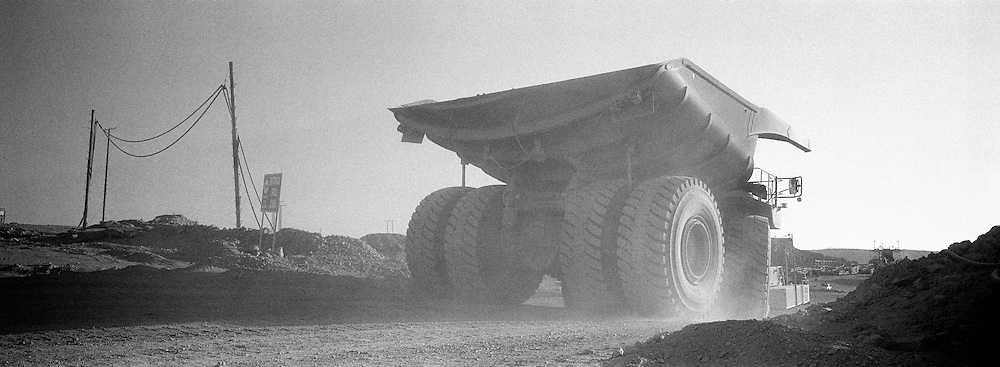 797B CAT truck driving away in mine