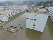 BIJIE, CHINA - JUNE 28: <br /> <br /> Aerial view of the flood caused by heavy rain in Zhijin County on June 28, 2016 in Bijie, Guizhou Province of China. Over 10 hours continuous heavy rain caused 2 people died, 1 still missing and the direct economic loss of 115.62 million yuan (about 17.39 million USD) till Tuesday in Zhijin County, Guizhou Province. <br /> ©Exclusivepix Media