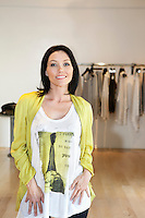 Portrait of a beautiful mid adult woman standing in fashion store