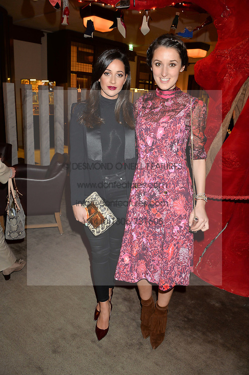 Left to right, ROXIE NAFOUSI and ROSANNA FALCONER at the unveiling of a Very Special Malone Souliers Christmas Tree, In Support Of Starlight Children's Foundation held at The Club Cafe Royal, Regent Street, London on 2nd December 2015.