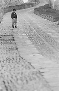 Boy on brick road, Cusco, Peru, 2003